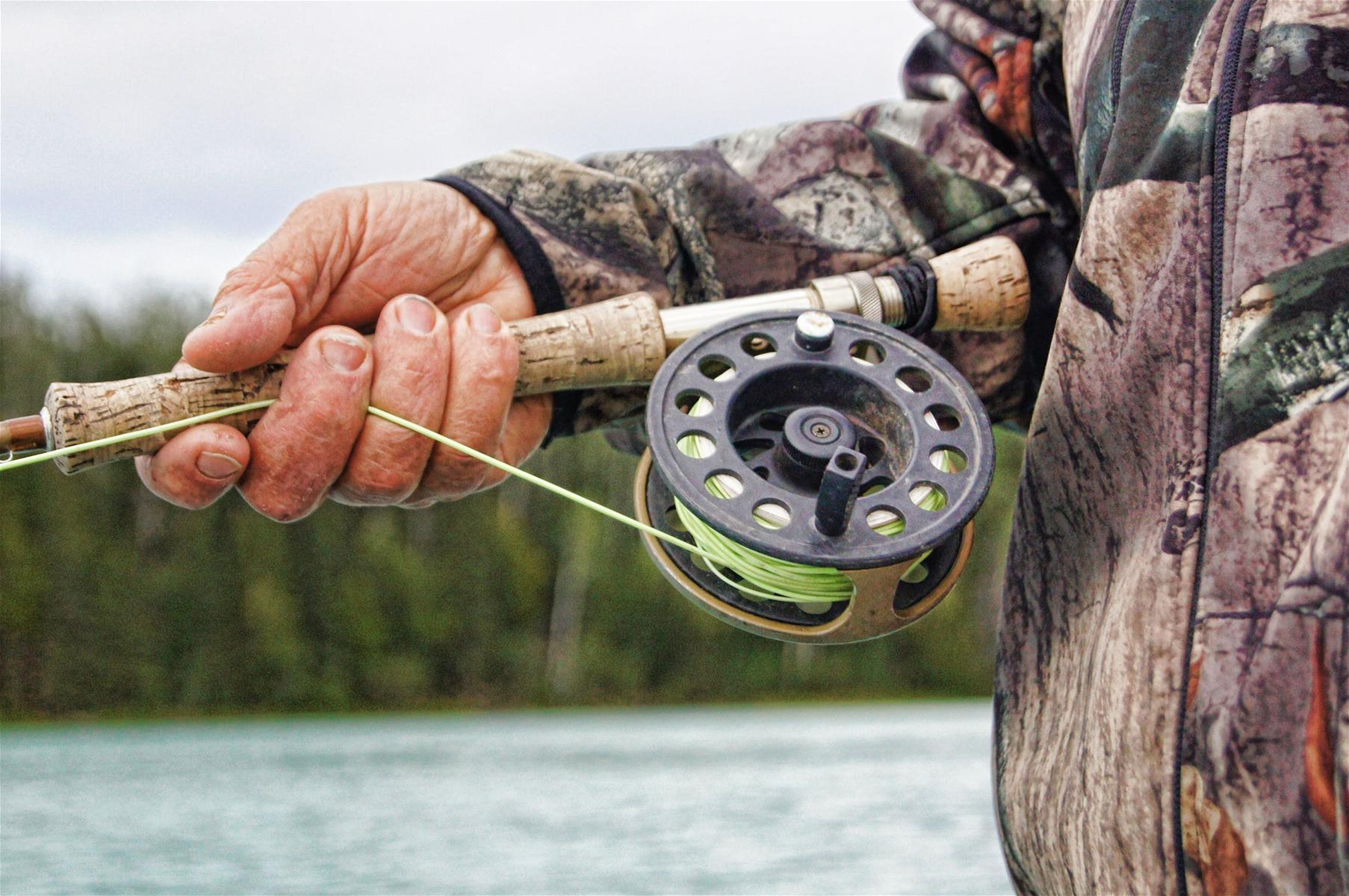 fisherman-fishing-reel-river-39854.jpeg